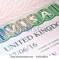 stock-photo-visa-to-uk-united-kingdom-visa-vignette-in-passport-macro-image-selective-focus-645219814